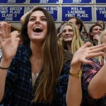Seniors Sophie Thiede, Emma Hendersen and Ellie Mitchell clap after the Lancers make a free throw. Photo by Diana Percy