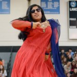 Sophomore Anika Radadiya performs a more modern take on a Bollywod dance, complete with sunglasses as a part of her outfit. Photo by Diana Percy
