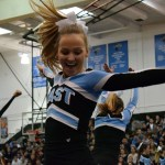 Junior Anna McClelland performs during the Varsity Cheer routine. Photo by Audrey Kesler