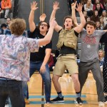 Senior Brayton Bowers leads yell leaders in the new school chant. Photo by Carson Holtgraves