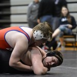 Sophomore Cooper Lovelace struggles as his opponent attempts to pin him. Photo by Celia Hack