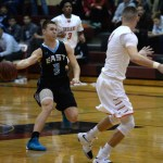 Senior Trevor Thompson passes the ball to junior Kelyn Bolton, who then goes up for a layup. Photo by Kaitlyn Stratman