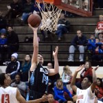 Near the beginning of the game, senior Connor Rieg jumps and makes a shot. Photo by Kaitlyn Stratman