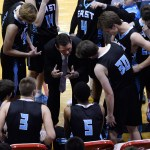 The team circles around Coach Hair as he talks to them about how they can improve for the rest of the game. Photo by Kaitlyn Stratman