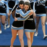 Sophomores Elle Angelo and Sophie Strick hug after their cheer performance. Photo by  Kaitlyn Stratman