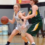 Sophomore Lauren Sandow makes her way past a South defender. Photo by Izzy Zanone