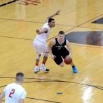Senior Trevor Thompson steals the ball and dribbles to make a basketball. Photo by Maddie Smiley