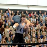 Junior Andrew Schmidt carries senior Fibrizzio Bortolotti on his shoulders while performing a comedic wrestling match. Photo by Maddie Smiley