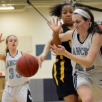 Sophomore Elizabeth Ballew reaches through another players arms in an attempt to grab the ball. Photo by Ellen Swanson
