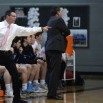 J.V. Basketball Coach, BJ Hair, stands to yell at the East players as they play defense. Photo by Celia Hack