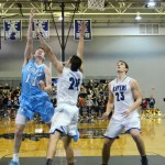Senior Connor Rieg makes a layup. Photo by Luke Hoffman