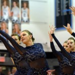Junior Emma Renwick reaches her hand during the Lancer Dancers performance, Stubborn Love, that they are competing with at Nationals. Photo by Katherine Odell