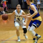 Senior Kyle Haverty looks at and dribbles toward the basket. Photo by Audrey Kesler