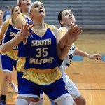 Junior Katie Hise attempts to block defender to gain the rebound. Photo by Audrey Kesler