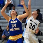 Junior Katie Hise reaches for the rebound with her defender. Photo by Audrey Kesler