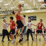 """Senior Zac Medley blocks senior Cameron Fritz's shot. Fritz talked about playing against his friends and said, """"I think you still want to win but it's not as competitive or serious"""". Photo by Audrey Kesler"""