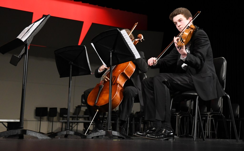 Senior Joey Gasperi plays the viola in the String Quartet at Collage Night. Photo by Haley Bell