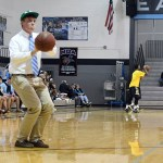 Senior Matt Schotte attempts to make a basket during half-time of the game. Photo by Haley Bell