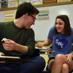 Juniors Anna Kanaley and Denny Rice share a laugh as they struggle to eat their sushi. Photo by Ellie Thoma