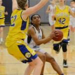 Sophomore Destiny Rae prepares to shoot a basket. Photo by Ellen Swanson