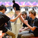 Waiting for his turn to bowl, sophomore Gray Warner makes up a handshake with one of his teammates. Photo by Grace Goldman