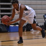 Sophomore Yasmeen Byers grabs the ball before it goes out of bounds. Photo by Reilly Moreland