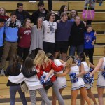 The cheerleaders and student section sing the school song. Photo by Reilly Moreland