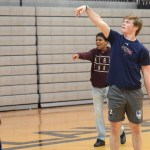 After making a basket, sophomore Griffin Fries cheers in excitement. Photo by Morgan Plunkett