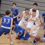 Freshman Hayden Talge (Front), Freshman Hsiung Vincent (Middle) and Freshman JJ Ruff fight to get to the ball while a player from the other team falls. Photo by CJ Manne