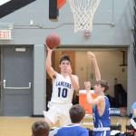 Freshman Alec Stamati makes a shot. Photo by CJ Manne