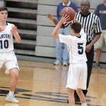 Freshman Jack Kloster passes the ball to Freshman Alec Stamati. Photo by CJ Manne