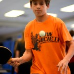 Sophomore Corbin Carroll focuses on the ping pong return. Carroll won the match 2-1 against KCC player. Photo by Annie Lomshek