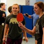 """Senior Camille Moore makes a forehand swing at the ball.  """"Tennis has definitely influenced my skills,"""" Moore said.  """"It's so similar, but ping pong is more fun"""". Photo by Annie Lomshek"""