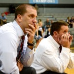Coaches B.J. Hair, Ryan Oettmeier, and Shawn Hair are on the edge of their seats as the team comes closer to upping the score in first minutes of overtime. Photo by Annie Lomshek