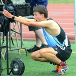 Senior Will Clough kneels down to recover after his 800 meter race. Photo by Luke Hoffman