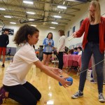 Freshman Sophie Sun helps junior Mary Beth Eddy how to lift the yo-yo into the air with strings. Photo by Diana Percy
