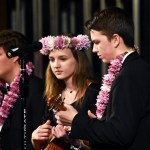 """Junior Chase Owens plays """"Somewhere Over the Rainbow"""" with sophomore Lily Murray and senior Parker Benion. Photo by Laini Reynolds"""