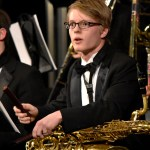 Sophomore Becker Truster plays the rhythm sticks during the orchestras performance. Photo by Laini Reynolds