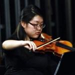 Senior Yashi Wang performs with seniors Joey Gasperi, Clayton Phillips, and Ben Robinson. Photo by Laini Reynolds
