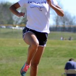 Sophomore Lauren Winston practices her long jump for the meet Friday. Photo by Katherine McGinness