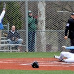 Freshman Robert Moore cheers as senior Ryan Stubbers slides into home plate. Photo by Izzy Zanone