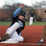 Senior Cameron Fritz slides into third base during a pick-off drill. Photo by Kaitlyn Stratman