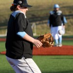 Sophomore Justin Randa flinches as an unexpected fastball comes his way. Photo by Kaitlyn Stratman