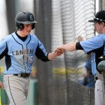 Sophomore Justin Randa is congratulated by his teammate after batting. Randa had one hit for the game. Photo by Kaitlyn Stratman