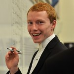 Senior Nick Kashka jokes around during the band's concert preparation. Photo by Libby Wilson