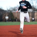 Junior Max Aebersold sprints to the base during a base running exercise. Photo by Morgan Browning