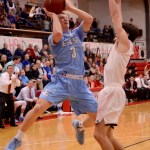 Senior Trevor Thompson shoots for the basket while his opponent blocks him. Photo by Maddie Smiley