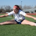 Senior, Hope Dunn, stretches her legs before practice. Photo by Ava Simonsen