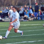 Freshman Karoline Nelson prepares to kick the ball into the net. Photo by Reilly Moreland