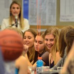 Senior Quincy Bair laughs with Junior Laura Adams during Coach Lawrence's speech. Photo by Sophie Storbeck